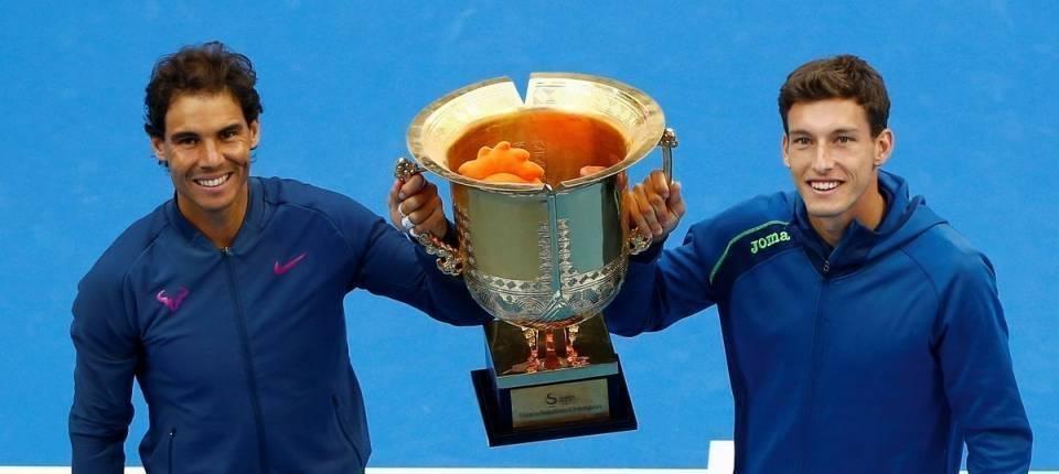 Rafa Nadal y Pablo Carreño alzando el trofeo de campeones en el China Open 2016