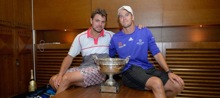 Norman posando con Wawrinka tras ganar Roland Garros 2015 (C) Pool/Getty Images Europe