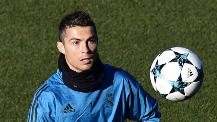 Cristiano Ronaldo durante este martes con el Real Madrid, previo a su partido de mañana de Champions contra el Dortmund (C) AFP PHOTO / PIERRE-PHILIPPE MARCOU